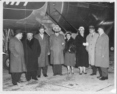 Photograph of Rabbi Silver with other individuals in front of an airplane