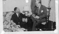 Photograph of Rabbi Eliezer Silver sitting on a couch with another Rabbi