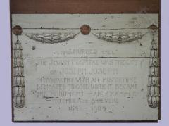 "Wood memorial board with inscription, ""The Jewish Hospital was the gift of Joseph Joseph . in sympathy with all misfortune dedicated to good work it became his monument-an example to emulate & revere, 1847-1904"""