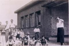 Photo Henry Blumenstein with group of kids