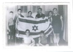 Photo Young Werner and others with the flag of Israel