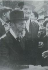 Rabbi Elizer Silver Standing, Surrounded by Young Boys