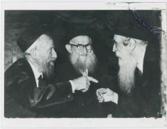 Picture of Rabbi Eliezer Silver in animated conversation with two other Rabbis