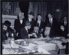 Rabbi Eliezer Silver Making a Kinyan (Acquisition) with a Chassan (Groom) while serving as Misader Kiddushin (Officiating Rabbi) at an Unidentified Wedding
