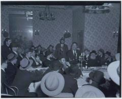 Picture of Rabbi Eliezer Silver Speaking at a Unidentified Wedding, Surrounded by Unidentified Rabbanim