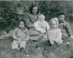 Unidentified woman and children